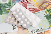 Euro banknotes with medicines — Stock Photo