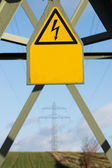 Electricity pylon with sign — Stock Photo
