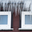Icicles in front of two windows — Stock Photo