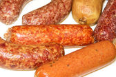 Plate with sausages — Stock Photo