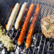 Grill with sausages and meat — Stock Photo