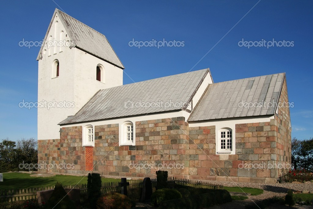 Old church in Denmark in front of a blue sky  Stock Photo #9775396