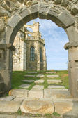 Church behind arc in Castro Urdiales, Cantabria, Spain — Stock Photo