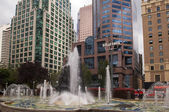 Fountain among skyscrapers — Stock Photo