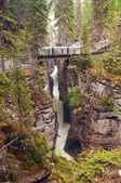 Bridge across mountain river — Stock Photo