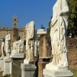 Ancient Roman statues on pedestals — Stock Photo