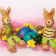 Stock Photo: Toy Easter rabbits and dyed eggs