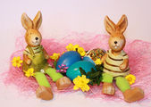 Easter rabbits and dyed eggs — Stock Photo