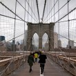 Walking Brooklyn Bridge - Stock Photo