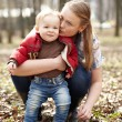 Stock Photo: Young mother and son