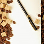 Coffee beans, paper, pen — Stock Photo
