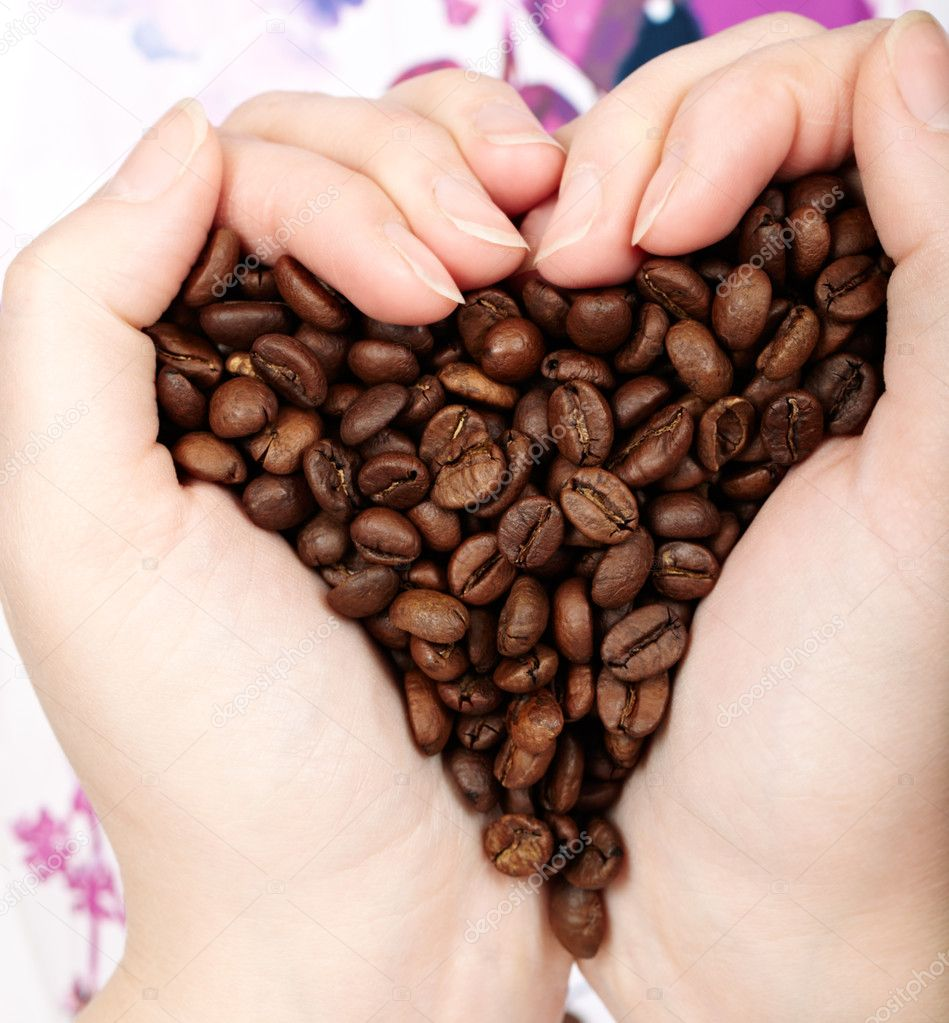 Heart of cofee grains in hands. Natural morning light. — Stock Photo #10590496