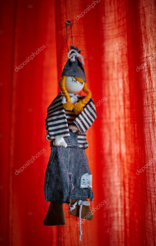 Handmade toy from jeans clothes hanged on curtain — Stock Photo #10590609