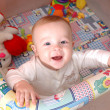 Stock Photo: Smiling child playing in cot, family scenes