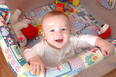 Smiling child playing in the cot, family scenes — Stock Photo