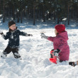 Boy and girl playing snowballs — Stock Photo #8699115