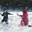 Boy and girl playing snowballs — Stock Photo