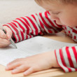 Stock Photo: Little boy learning to write