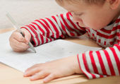 Little boy learning to write — Stok fotoğraf