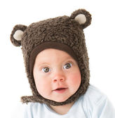 Little boy in a cap with ear flaps — Stock Photo