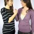Stock Photo: Female models holding hand sign of friendship
