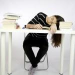 Girl sleeping while studying sitting — Stock Photo