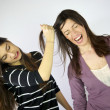 Girl pulling hard long hair of her friend — Stock Photo