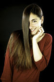 Young female model with amazing straight long hair — Stock Photo