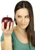 Girl out of focus watching apple in focus — Stock Photo