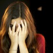 Girl hiding scared with behind her a black man — Stock Photo #10713292