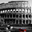 Colosseum with a red bus — Foto de Stock