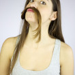 Funny girl making mustache with her very long hair — Stock Photo #9582428