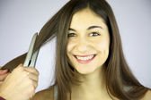 Girl gets her hair ironed smiling — Stock Photo