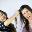 Girl pulling hair angry fighting — Stock Photo