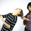 Girl pulls hard very long hair — Stock Photo #9649142