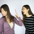 Stock Photo: Girls shouting at each other