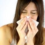 Sick girl sneezes — Stock Photo