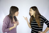 Girls arguing strongly very angry — Stock Photo