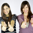 Two girls thumbs up smiling — Stock Photo