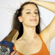 Female model drying her long hair — Stock Photo