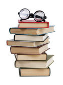 Glasses and a stack of books — Stock Photo