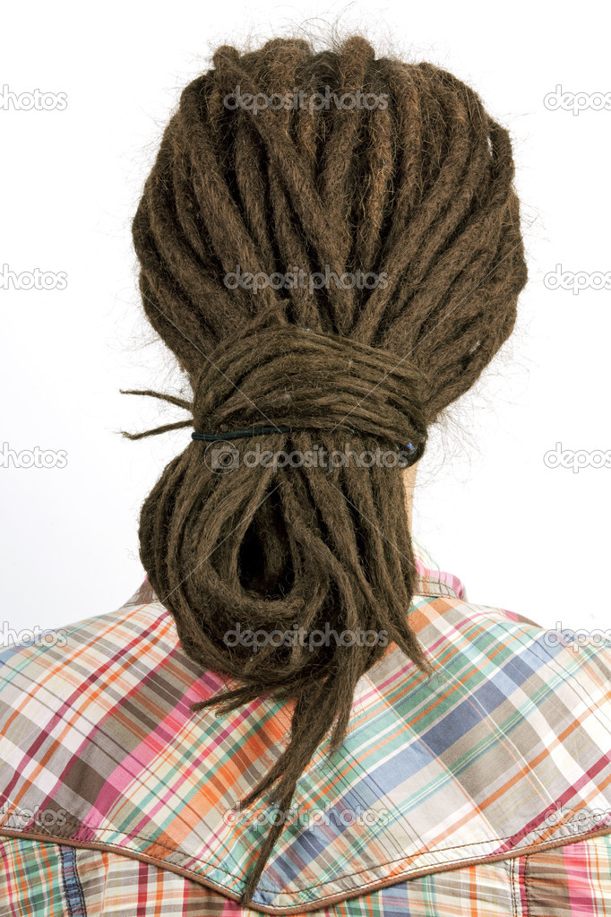 Young girl with hair in a dreadlocks on light background — Stock Photo #10427182