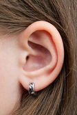The little girl's ear — Stock Photo
