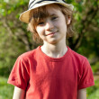 Stock Photo: Fair-haired boy in red shirt and hat