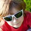 The fair-haired boy in sunglasses — Stock Photo