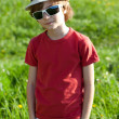 The fair-haired boy in red shirt - Stock Photo