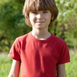 Stock Photo: Fair-haired boy in red T-shirt