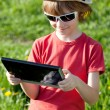 Boy playing with enthusiasm in the Tablet PC — Stock Photo