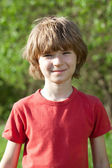Smiling boy with tousled hair — Stock Photo