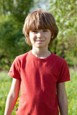 The fair-haired boy in a red T-shirt — Stock Photo